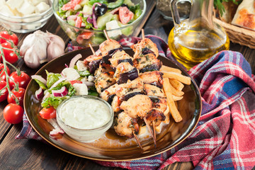 Chicken Souvlaki with french fries and tzatziki sauce