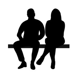 silhouette of a guy and a girl sitting