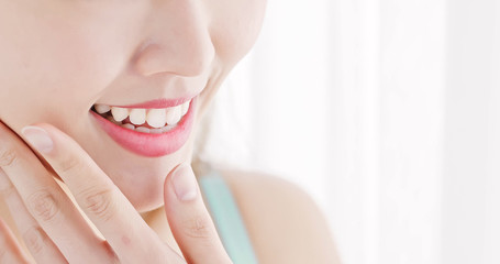 close up woman tooth
