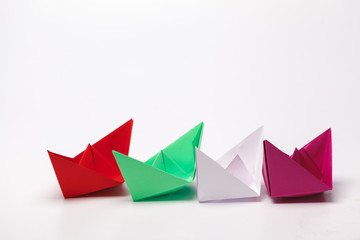 Set of origami paper boats. Leadership and business concept