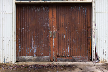 A set of weathered shed barn doors with faded paint as an abstract background