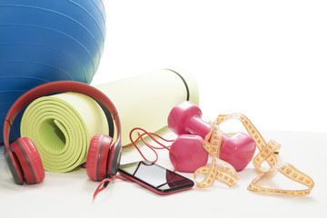 Fitness ball, dumbbells, Mat, smartphone and headphones