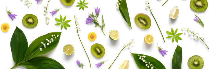 Fototapete - pattern from plants, wild flowers, lily of the valley, fruit kiwi, isolated on white background, flat lay, top view. The concept of summer, spring, Mother's Day, March 8.