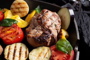 Grilled vegetable and meat on a charcoal