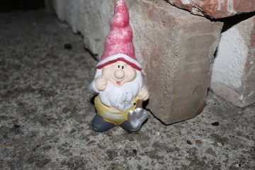 Garden gnome on concrete