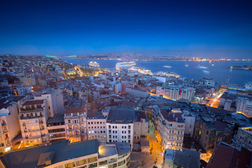 Long exposure cityscape of Istanbul at a night from Galata to the Bosphorus. Wonderful romantic old town at Sea of Marmara. Bright light of street lighting and cruise liners. Istanbul. Turkey.