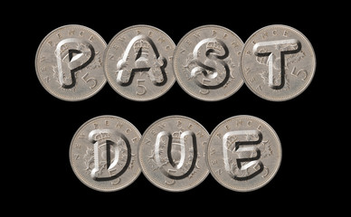 PAST DUE written with old British coins on black background