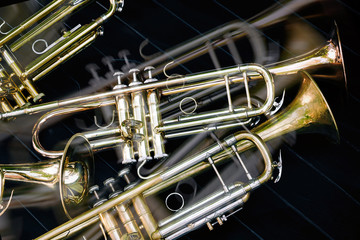 Several musical wind instruments orchestra golden trumpets.