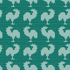 Knitting blue with roosters. Seamless pattern background. Embroidery and needlework. Vector illustration.