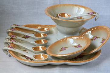 brown set with plates and spoons