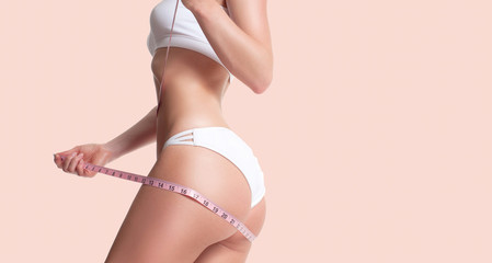 Successful weight loss, beautiful female bottom, diet concept