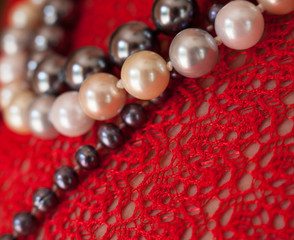 Strings of beads on the red blouse.