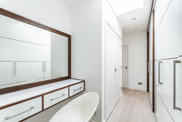 walk in wardrobe and dressing room in white