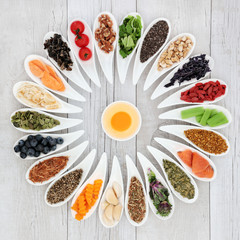 Health food wheel with ingredients to improve brain power. Super foods concept high in minerals, vitamins, antioxidants, omega 3 and anthocyanins.
