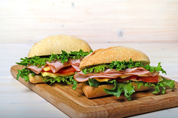 Two frash sandwiches with ham and vegetables