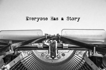 Everyone Has a Story typed text on a vintage typewriter. Close-up