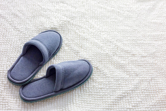 grey Slippers on the carpet