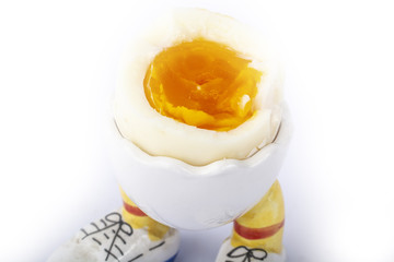 boiled egg open half with legs isolate