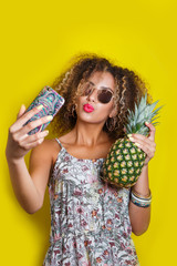 Beautiful Girl selfie with a smartphone. Beautiful young African American woman with afro hairstyle