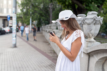 Woman with the smartphone outdoors