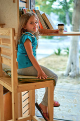 little girl drinking coffee at the table