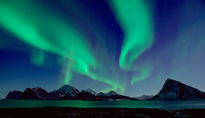 Photo sur Toile Aurore polaire Northern Lights, Aurora Borealis shining green in night starry sky at winter Lofoten Islands, Norway