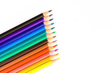 Group of pencils of colors against a white background with space copy