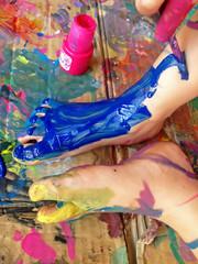 little girl painting her feet
