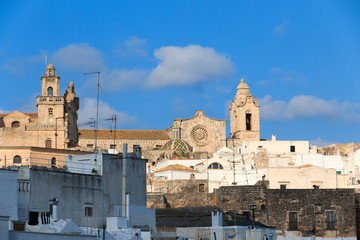 """Italy, SE Italy, Ostuni. Stone building, Cathedral Bell Tower, """"The White City."""