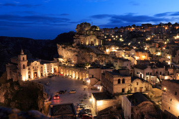 Italy, Southern Italy, Region of Basilicata, Province of Matera, Matera. The town lies in a small canyon carved out by the Gravina. Overview of town. The cave church Madonna de Idris.