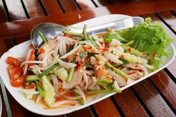 Close up spicy grilled pork salad