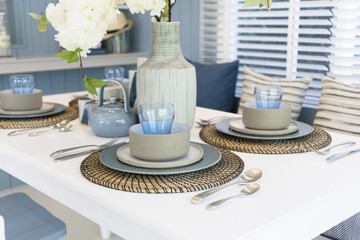 blue and rustic style dining table set at home