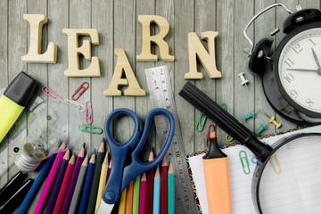 Stationery supplies with text of learn