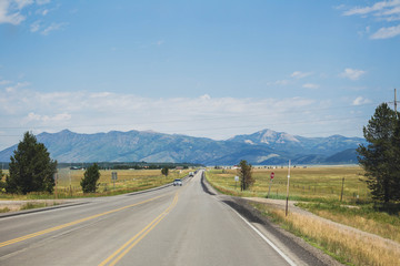Highway in remote Montana landscape. Summer day setting.