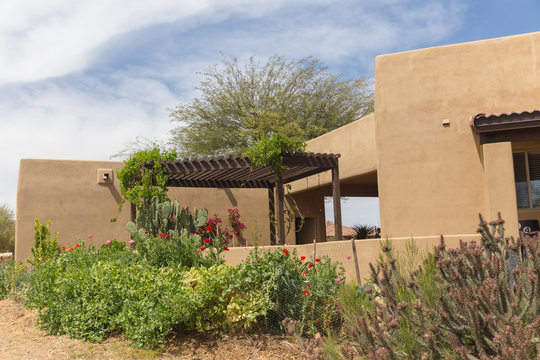 Stucco Home with Beautiful Garden and Pergola