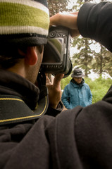 Photographer Taking Pictures of a Group of Men in Alaskan Wilderness