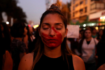 A woman attends a rally against gender violence in Santiago