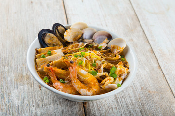 seafood curry noodle with wood background