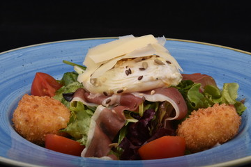 salad with tomatoes, smoked ham,cheese and mayonnaise