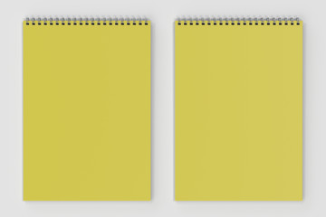 Blank yellow notebook with metal spiral bound on white background