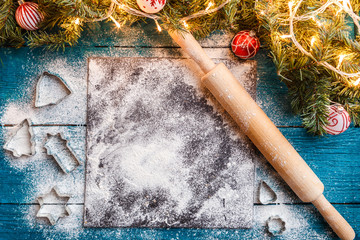 Photo of rolling pin, flour, spruce branches, garlands