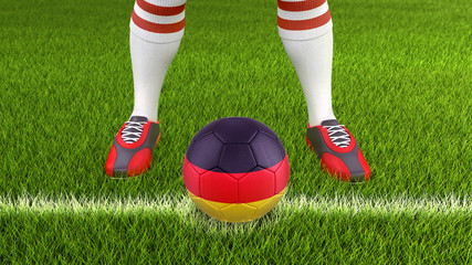 Man and soccer ball  with German flag
