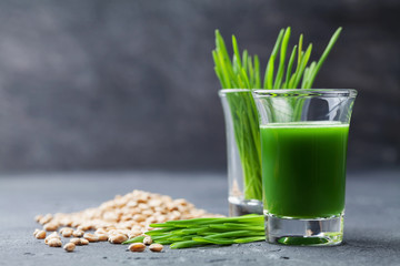 Natural wheat grass juice. Detox, diet and superfood concept.