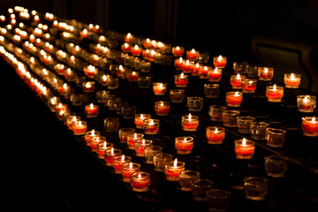 A lot of candles in church.