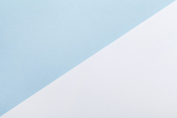 Minimal geometric pastel background. Blue and white paper color in flat lay style.