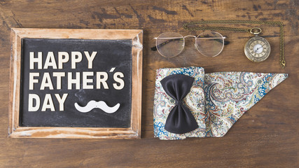 Fathers day composition with accessories and slate