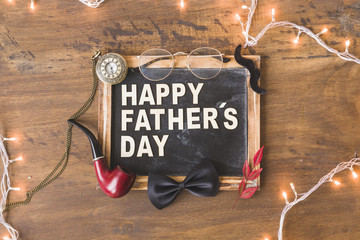 Fathers day composition with slate and string lights