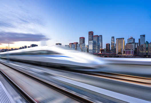 high speed train with cityscape
