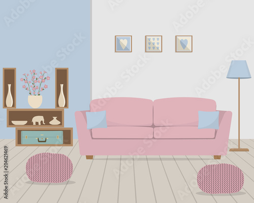 Living room in retro style. There is a pink sofa with blue pillows ...