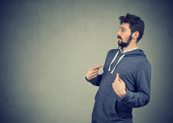 man pointing fingers at himself being in denial